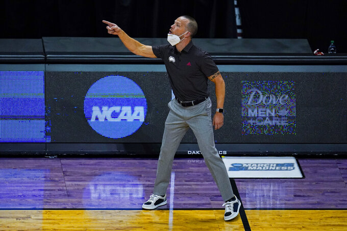 Winthrop head coach Pat Kelsey yells to his team as they played against Villanova in the first half of a first round game in the NCAA men's college basketball tournament at Farmers Coliseum in Indianapolis, Friday, March 19, 2021. (AP Photo/Michael Conroy)
