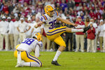 FILE - LSU kicker Cade York (36) kicks an extra point with punter Zach Von Rosenberg (38) holding during the first half of an NCAA college football game in Tuscaloosa, Ala., in this Saturday, Nov. 9, 2019, file photo. York was selected to The Associated Press Preseason All-America first team offense, Monday Aug. 23, 2021. (AP Photo/Vasha Hunt, File)