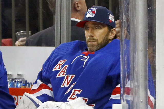 FILE - Then-New York Rangers goaltender Henrik Lundqvist looks on from the bench during an NHL hockey game against the Buffalo Sabres in New York, in this Friday, Feb. 7, 2020, file photo. Star goalie Henrik Lundqvist will sit out the upcoming NHL season because of a heart condition, announcing the news a little more than two months after joining the Washington Capitals. Lundqvist posted a written statement and a videotaped one on social media Thursday, Dec. 17, 2020, saying it was a
