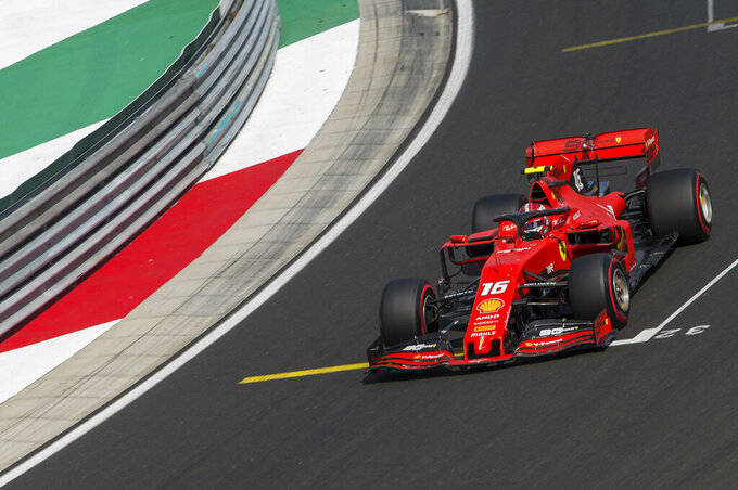 Monaco's Formula One driver Charles Leclerc of Ferrari speeds his car during the qualification session for the Hungarian Formula One Grand Prix at the Hungaroring circuit, in Mogyorod, Hungary, Saturday, August 3, 2019. The Hungarian Formula One Grand Prix will take place on Sunday, August 4, 2019. (Zoltan Balogh/MTI via AP)