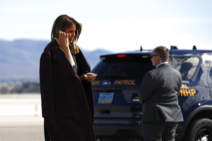 FILE - In this March 5, 2019 file photo first lady Melania Trump boards an aircraft at McCarran International Airport in Paradise, Nev. Nevada's rising political prominence is attracting more visits from the president, vice president and other high-profile political figures that are driving up costs for state troopers assigned to help protect them while they're in the state. It's expected to be even more costly next year, with Trump's re-election campaign targeting swing-state Nevada and a crowded field of Democrats who might start receiving protection as they barnstorm the state. (AP Photo/Patrick Semansky,File)