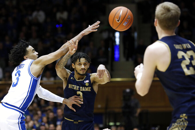 Duke guard Tre Jones (3) pressures Notre Dame guard Prentiss Hubb while Prentiss passes to guard Dane Goodwin (23) during the first half of an NCAA college basketball game in Durham, N.C., Saturday, Feb. 15, 2020. (AP Photo/Gerry Broome)