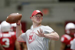 In this photo taken Aug. 7, 2019, Nebraska head coach Scott Frost throws a pass during NCAA college football preseason practice in Lincoln, Neb. Frost's first Nebraska team started 0-6 and finished 4-8, the same record as in 2017 under Mike Riley. Wins in four of the last six, though, left an entirely different perception of the program and where it appears to be heading. (AP Photo/Nati Harnik)