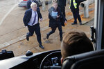 Britain's Prime Minister Boris Johnson runs to his campaign bus after a visit to Wilton Engineering Services, part of a General Election campaign trail in Middlesbrough, England, Wednesday, Nov. 20, 2019. Britain goes to the polls on Dec. 12. (AP Photo/Frank Augstein, Pool)