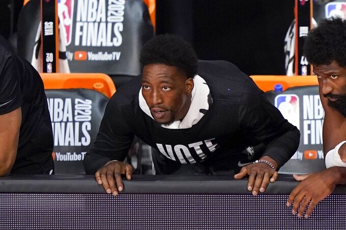 Miami Heat's Bam Adebayo, watches play against the Los Angeles Lakers during the first half of Game 2 of basketball's NBA Finals, Friday, Oct. 2, 2020, in Lake Buena Vista, Fla. (AP Photo/Mark J. Terrill)