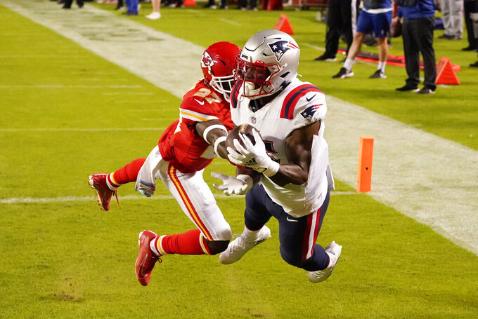 New England Patriots wide receiver N'Keal Harry (15) catches a 4-yard touchdown pass ahead of Kansas City Chiefs cornerback Rashad Fenton (27) during the second half of an NFL football game, Monday, Oct. 5, 2020, in Kansas City. (AP Photo/Charlie Riedel)