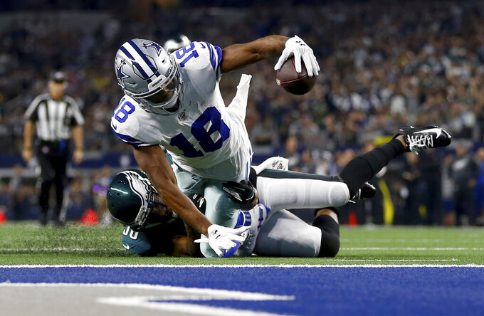 Dallas Cowboys wide receiver Randall Cobb (18) is stopped shy of the end zone after catching a pass by Philadelphia Eagles running back Boston Scott (38) in the first half of an NFL football game in Arlington, Texas, Sunday, Oct. 20, 2019. (AP Photo/Ron Jenkins)