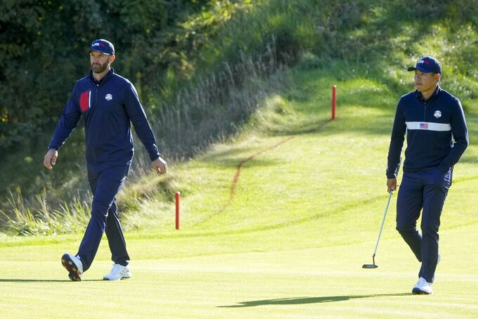 Team USA's Dustin Johnson and Team USA's Collin Morikawa walk to the ninth green during a foursomes match the Ryder Cup at the Whistling Straits Golf Course Saturday, Sept. 25, 2021, in Sheboygan, Wis. (AP Photo/Charlie Neibergall)