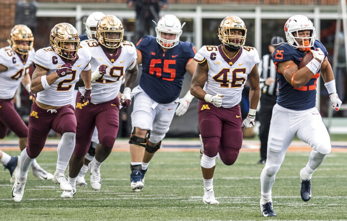 Illinois' Dre Brown (25) out runs for a touchdown against Minnesota in the first half of an NCAA  college football game, Saturday, Nov. 3, 2018, in Champaign, Ill. (AP Photo/Holly Hart)