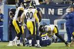 Tennessee Titans quarterback Marcus Mariota (8) is sacked in the end zone by the Pittsburgh Steelers defense, including Bud Dupree (48), for a safety in the first half of a preseason NFL football game Sunday, Aug. 25, 2019, in Nashville, Tenn. (AP Photo/James Kenney)