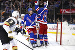 New York Rangers left wing Brendan Lemieux (48) and right wing Jesper Fast (17) celebrate Lemieux's goal during the second period of an NHL hockey game against the Vegas Golden Knights, Monday, Dec. 2, 2019, in New York.  Golden Knights defenseman Brayden McNabb (3) looks on. (AP Photo/Kathy Willens)