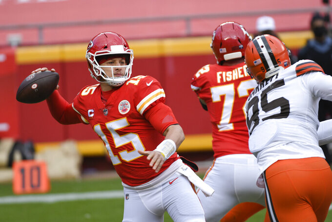 Kansas City Chiefs quarterback Patrick Mahomes (15) throws a pass during the first half of an NFL divisional round football game against the Cleveland Browns, Sunday, Jan. 17, 2021, in Kansas City. (AP Photo/Reed Hoffmann)