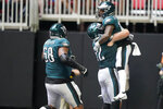 Philadelphia Eagles running back Kenneth Gainwell (14) celebrates his touchdown against the Atlanta Falcons during the second half of an NFL football game, Sunday, Sept. 12, 2021, in Atlanta. (AP Photo/Brynn Anderson)