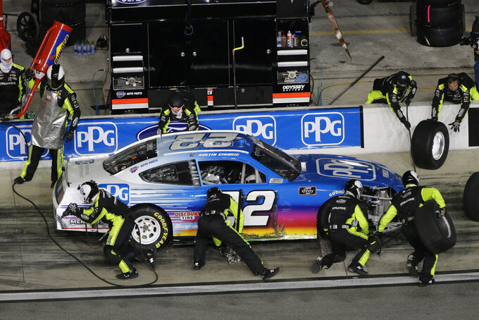 Austin Cindric makes a pit stop during the NASCAR Xfinity Series road course auto race at Daytona International Speedway, Saturday, Feb. 20, 2021, in Daytona Beach, Fla. (AP Photo/Terry Renna)