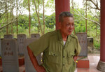 In this Feb. 16, 2019, photo, veteran Duong Van Dau stands in front of headstones at a memorial for North Korean fallen pilots in Bac Giang province, Vietnam. The fourteen headstones of the pilots who died while fighting American bombers alongside the Vietnamese army during the Vietnam war remain as a symbol of Vietnam-North Korea friendship. (AP Photo/Hau Dinh)