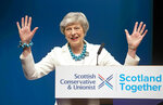Prime Minister Theresa May addresses delegates during the Scottish Conservatives' annual party conference at the Aberdeen Exhibition and Conference Centre, Friday May 3, 2019. Britain's main Conservative and Labour parties took a hammering in local elections as Brexit-weary voters expressed frustration over the country's stalled departure from the European Union. (Jane Barlow/PA via AP)