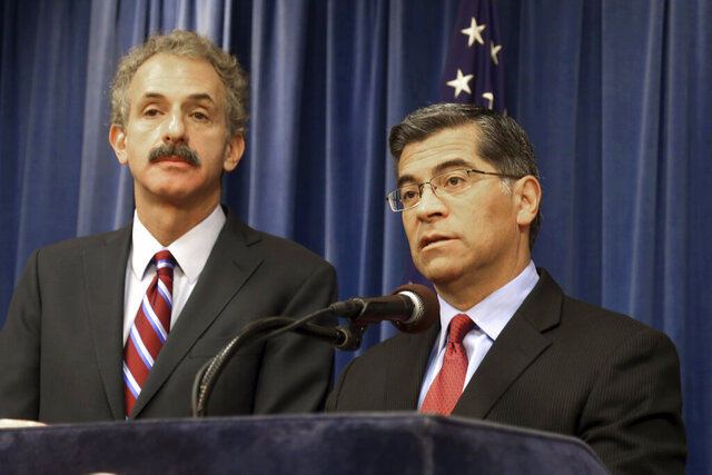 FILE - In this Feb. 6, 2018, file photo, California Attorney General Xavier Becerra, right, and Los Angeles City Attorney Mike Feuer appear at a news conference in Los Angeles. California-based federal judges have joined in blocking President Donald Trump's executive order excluding people in the U.S. illegally from being counted when congressional districts are redrawn after this year's census. Becerra said a complete and accurate census count