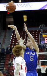 Air Force's Christopher Joyce shoots as Fresno State's Noah Blackwell defends during the first half of an NCAA college basketball game in the Mountain West Conference men's tournament Thursday, March 14, 2019, in Las Vegas. (AP Photo/Isaac Brekken)