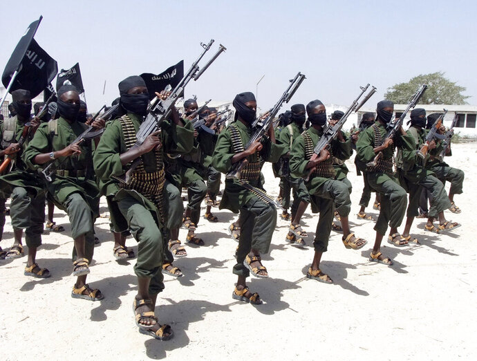 FILE - In this Thursday, Feb. 17, 2011 file photo, hundreds of newly trained al-Shabab fighters perform military exercises in the Lafofe area some 18 km south of Mogadishu, in Somalia. U.N. experts said in a report circulated Tuesday, Nov. 12, 2019 that al-Shabab extremists in Somalia remain