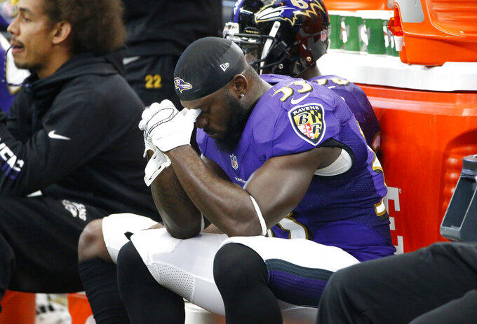 FILE - In this Nov. 20, 2016, file photo, Baltimore Ravens' Matt Elam sits on the bench late in the second half of an NFL football game against the Dallas Cowboys in Arlington, Texas. After being arrested on drug charges in February 2017, Elam was released. He finished with one interception during his short NFL career. (AP Photo/Ron Jenkins, File)