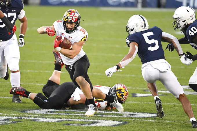 Maryland running back Jake Funk (34) eludes Penn State cornerback Tariq Castro-Fields (5) on a second-quarter touchdown run during an NCAA college football game in State College, Pa., Saturday, Nov. 7, 2020. (AP Photo/Barry Reeger)