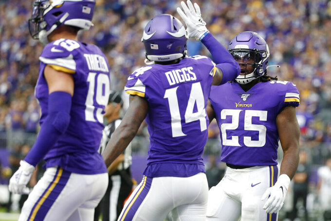 Minnesota Vikings running back Alexander Mattison (25) celebrates with teammate Stefon Diggs (14) after scoring on a 10-yard touchdown run during the second half of an NFL football game against the Oakland Raiders, Sunday, Sept. 22, 2019, in Minneapolis. (AP Photo/Bruce Kluckhohn)