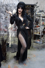 """FILE - Cassandra Peterson, who plays """"Elvira, Mistress of the Dark,"""" appears during the NBC """"Today"""" television program's annual Halloween show in New York on Oct. 31, 2007. Elvira turns 70 on Sept. 17. (AP Photo/Richard Drew, File)"""