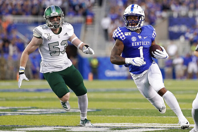 Kentucky wide receiver Lynn Bowden Jr. (1) runs with the ball during the first half of an NCAA college football game between Kentucky and Eastern Michigan, Saturday, Sept. 7, 2019, in Lexington, Ky. (AP Photo/Bryan Woolston)