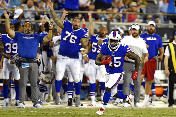 Buffalo Bills running back Christian Wade (45) finds some running room during the second half an NFL preseason football game against the Carolina Panthers in Charlotte, N.C., Friday, Aug. 16, 2019. (AP Photo/Mike McCarn)