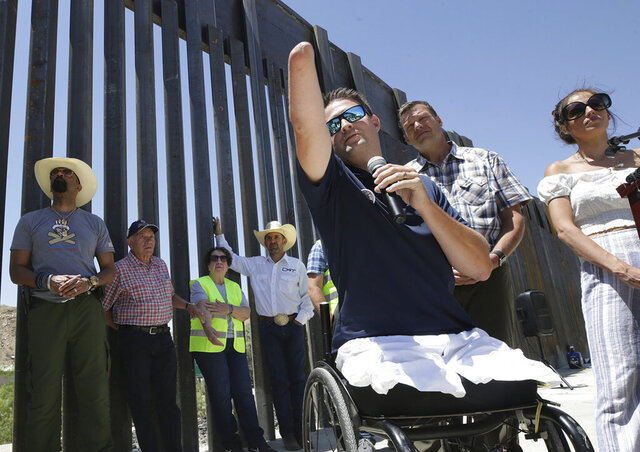 """FILE - In this May 30, 2019 file photo, Brian Kolfage, founder of We Build the Wall Inc., speaks at a news conference in Sunland Park, N.M., where a privately funded wall is being constructed. Former White House adviser Steve Bannon was arrested Thursday, Aug. 20, 2020, on charges that he and three others, including Kolfage, ripped off donors to the online fundraising scheme """"We Build The Wall.""""  (Mark Lambie/The El Paso Times via AP, File)"""