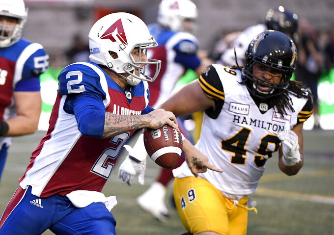 FILE - In this Aug. 3, 2018, file photo, Montreal Alouettes quarterback Johnny Manziel (2) runs with the ball against the Hamilton Tiger-Cats during the first half of a Canadian Football League game in Montreal. Manziel has been signed by the Alliance of American Football and will join the Memphis Express.  The quarterback's rights belonged to San Antonio of the spring league, but that team declined to sign him and Manziel then was free to join any of the other seven clubs.(Paul Chiasson/The Canadian Press via AP, File)