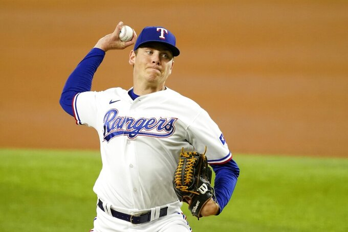 Texas Rangers starting pitcher Spencer Howard throws in the first inning of a baseball game against the Houston Astros in Arlington, Texas, Monday, Sept. 13, 2021. (AP Photo/Tony Gutierrez)