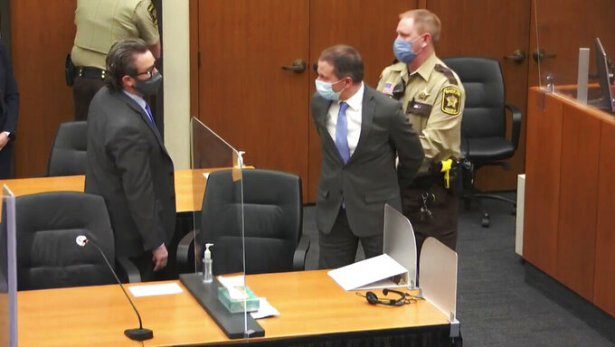 FILE - In this April 20, 2021 file image from video, former Minneapolis police Officer Derek Chauvin, center, is taken into custody as his attorney, Eric Nelson, left, looks on, after the verdicts were read at Chauvin's trial for the 2020 death of George Floyd, at the Hennepin County Courthouse in Minneapolis, Minn. Chauvin, convicted of murder in the death of Floyd is scheduled to make his initial appearance via videoconference, Tuesday, June 1, 2021, on federal charges that he violated Floyd's civil rights when he placed his knee on the Black man's neck, pinning him to the street. (Court TV via AP, Pool, File)