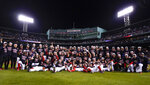 The Boston Red Sox pose for a photo on the field after defeating the Tampa Bay Rays 6-5 in Game 4 of a baseball American League Division Series, Monday, Oct. 11, 2021, in Boston. (AP Photo/Charles Krupa)
