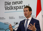 Sebastian Kurz head of the Austrian People's Party, OEVP, speaks to journalists during a press conference about the beginning of the coalition negotiations with the Austrian Greens in Vienna, Austria, Monday, Nov. 11, 2019. The slogan in the back ground reads:
