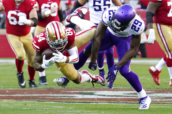 San Francisco 49ers wide receiver Kendrick Bourne (84) catches a pass ahead of Minnesota Vikings cornerback Xavier Rhodes (29) during the second half of an NFL divisional playoff football game, Saturday, Jan. 11, 2020, in Santa Clara, Calif. (AP Photo/Tony Avelar)