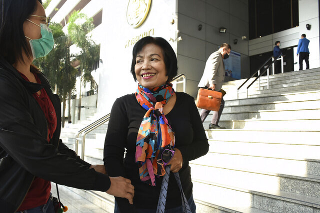 A woman identified only by her first name Anchan, right, talks to her friend as she arrives at the Bangkok Criminal Court in Bangkok, Thailand, Tuesday, Jan. 19, 2021. A court in Thailand on Tuesday sentenced the retired civil servant to a record 43.5 years in prison for insulting the monarchy by posting audio clips online of comments critical of the royal institution. (AP Photo)