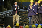 Vice President Mike Pence waves to steel workers as he arrives to address them at the Gerdau Ameristeel mill Thursday, May 9, 2019, in St. Paul, Minn. where he promoted the United States-Mexico-Canada Agreement. (AP Photo/Jim Mone)