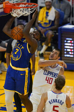 Golden State Warriors forward Eric Paschall (7) dunks over Los Angeles Clippers center Ivica Zubac (40) and guard Luke Kennard (5) during the first half of an NBA basketball game in San Francisco, Wednesday, Jan. 6, 2021. (AP Photo/Jeff Chiu)