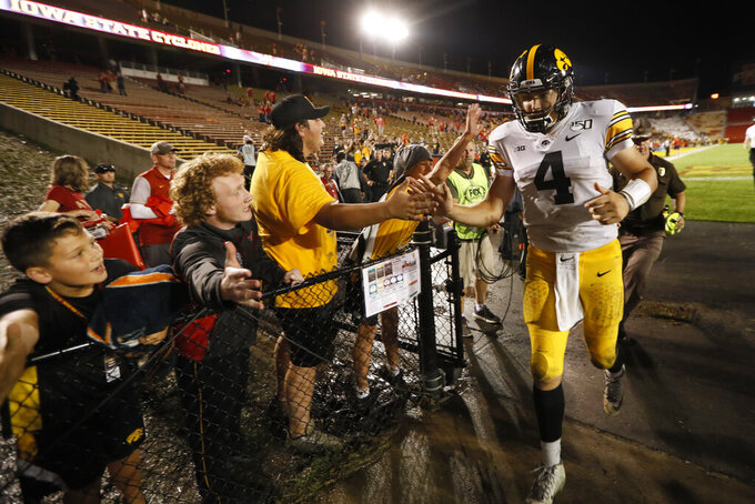 Iowa quarterback Nate Stanley (4) runs off the field after an NCAA college football game against Iowa State, Saturday, Sept. 14, 2019, in Ames, Iowa. (AP Photo/Charlie Neibergall)