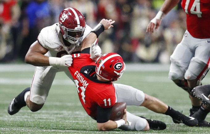 FILE - In this Jan. 8, 2018, file photo, Alabama's Raekwon Davis, top, sacks Georgia's Jake Fromm during the second half of the College Football Playoff National Championship football game in Atlanta. Saturday's SEC Championship, is the game the Bulldogs have wanted since last January, when the Alabama pulled out a 26-23 overtime victory in the national championship game. (AP Photo/David Goldman, File)