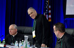 Cardinal Daniel DiNardo of the Archdiocese of Galveston-Houston, center, president of the United States Conference of Catholic Bishops, accompanied by Jose Gomez, archbishop of Los Angeles, left, and Rev. J. Brian Bransfield, right, get a sit before the morning prayer during the United States Conference of Catholic Bishops (USCCB), 2019 Spring meetings in Baltimore, Tuesday, Jun 11, 2019. (AP Photo/Jose Luis Magana)