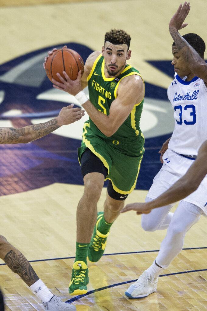 Oregon's Chris Duarte drives against Seton Hall's Shavar Reynolds Jr. during the second half of an NCAA college basketball game in Omaha, Neb., Friday, Dec. 4, 2020. (AP Photo/Kayla Wolf)