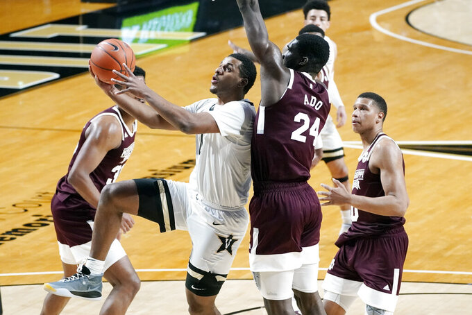 Vanderbilt guard Jordan Wright drives against Mississippi State forward Abdul Ado (24) in the first half of an NCAA college basketball game Saturday, Jan. 9, 2021, in Nashville, Tenn. (AP Photo/Mark Humphrey)