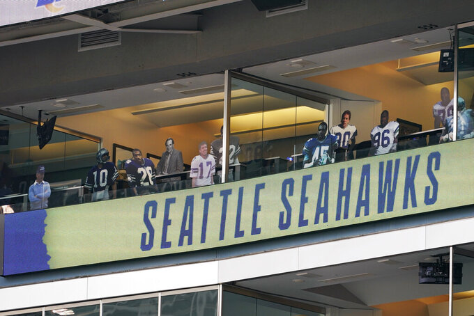 Life-size cut-out photos of former Seattle Seahawks players and coaches line a stadium suite before an NFL wild-card playoff football game against the Los Angeles Rams, Saturday, Jan. 9, 2021, in Seattle. (AP Photo/Ted S. Warren)
