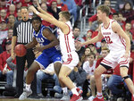 Wisconsin guard Brad Davison (34) and center Joe Hedstrom (32) defend against Eastern Illinois guard George Dixon (35) during the first half of an NCAA college basketball game in Madison, Wis., Friday, Nov. 8, 2019. (John Hart/Wisconsin State Journal via AP)