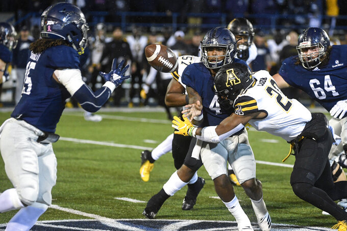 Georgia Southern quarterback Shai Werts (4) pitches to running back Monteo Garrett, left, while under pressure from Appalachian State linebacker Noel Cook (20) during the first half of an NCAA college football game, Thursday, Oct. 25, 2018, in Statesboro, Ga. (AP Photo/John Amis)