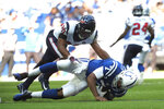 Indianapolis Colts quarterback Jacoby Brissett (7) is tackled by Houston Texans strong safety Justin Reid (20) during the first half of an NFL football game, Sunday, Oct. 20, 2019, in Indianapolis. (AP Photo/AJ Mast)