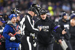 File-This Dec. 12, 2019, file photo shows Baltimore Ravens head coach John Harbaugh, right, talking to an official during the second half of an NFL football game against the New York Jets, in Baltimore. No matter how many spectacular plays Lamar Jackson and Russell Wilson made, officiating overshadowed the NFL this season. (AP Photo/Nick Wass, File)