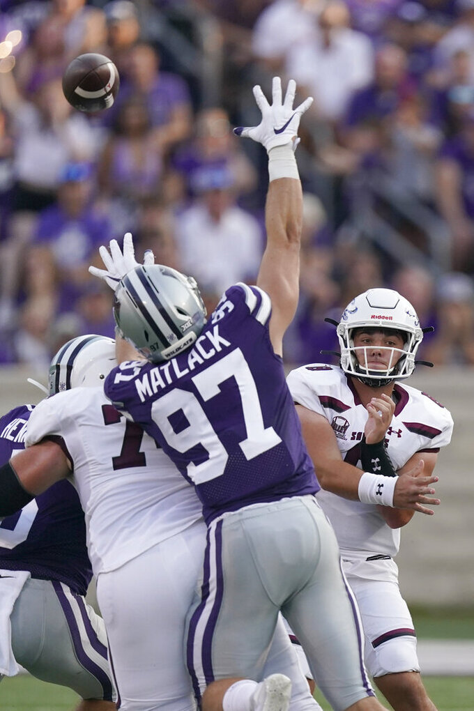 Southern Illinois quarterback Nic Baker, right, passes the ball during the first half of an NCAA college football game against Kansas State, Saturday, Sept. 11, 2021, in Manhattan, Kan. (AP Photo/Charlie Riedel)